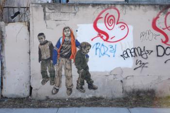 Swoon, Bethlehem Boys (2008/2010), woodcut and paint on wall.