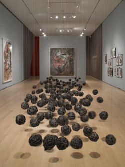 "installation view (Suspended Playtime at center) of ""Wangechi Mutu: A Fantastic Journey"" at the Brooklyn Museum through March 9, 2014. Courtesy of the Brooklyn Museum."