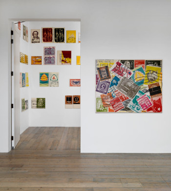 """Installation view: """"KP Brehmer. Real Capital Production,"""" Raven Row, 2014. Right: Auswahlbeutel Kiloware (Kiloware Assorted Bag) (1967), print on card, on melamine under plastic, 116 × 145 cm. Estate of  KP Brehmer, Berlin. Photo: Marcus J. Leith."""