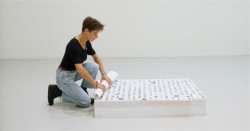 "Felix Gonzalez-Torres, ""Untitled"" (Death by Gun) (1990), stack of photo offset lithographs, composition 44 1/2 x 32 1/2 inches, 9 inches at ideal height. Endless copies. The Museum of Modern Art, purchased in part with funds from Arthur Fleischer, Jr. and Linda Barth Goldstein, ©The Felix Gonzalez-Torres Foundation."
